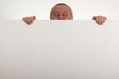 Senior peeps over top of blank white paper Stock Photography