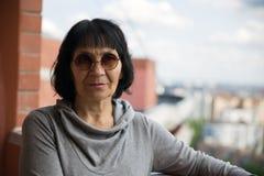 Senior pensioner woman in sunglasses Stock Image