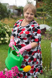Senior pensioner woman with watering can Royalty Free Stock Photography