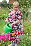 Senior pensioner woman with watering can Royalty Free Stock Photos