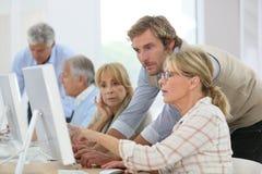 Senior people attending computing class royalty free stock photos