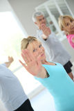 Senior people attending stretching course Stock Photos