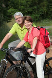 Senior people on bicycle ride Royalty Free Stock Image