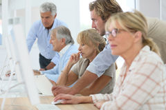 Senior people in business class training with instructor. Senior women in training business class stock photography