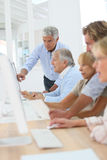 Senior people in computing class. Group of senior people in business training class Stock Images