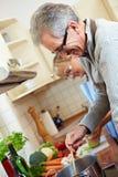 Senior people cooking Stock Image
