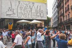 Senior people dance Sardana in Barcelona Royalty Free Stock Images