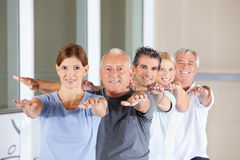 Senior people doing back exercises Stock Images
