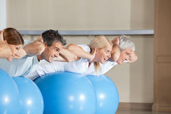 Senior people doing crunches on gym Royalty Free Stock Photography