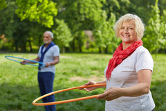Senior people doing fitness training in garden Stock Image