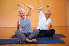 Senior people doing gymnastics stock image