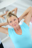 Senior people doing stretching excercises Stock Image