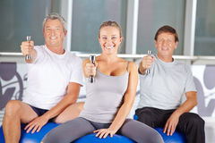 Senior people exercising with dumbbells in gym Stock Image