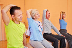 Senior people exercising in gym Stock Photos