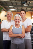 Senior people and fitness coach royalty free stock images