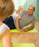 Senior people on fitness with instructor Royalty Free Stock Images