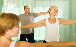 Senior people on fitness with instructor Stock Photography