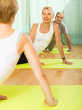 Senior people on fitness with instructor Stock Images