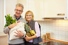 Senior people with groceries Royalty Free Stock Photography