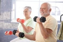 Senior people in the gym royalty free stock photo