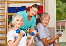 Senior people in gym exercising Stock Image