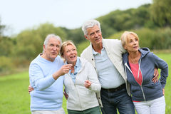 Senior people hanging outdoors admiring nature Royalty Free Stock Photography