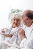 Senior people having romance Stock Images