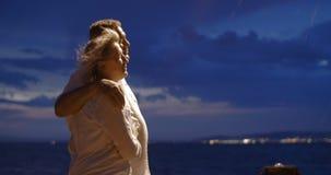 Senior people having walk along the sea at night stock video footage