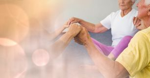 Senior people holding hands in gym. Digital composite of Senior people holding hands in gym Royalty Free Stock Photos