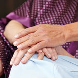 Senior people holding hands Stock Photos