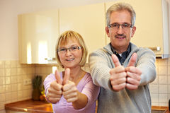 Senior people holding thumbs up Stock Photo