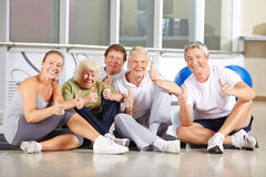 Senior people holding thumbs up Royalty Free Stock Image