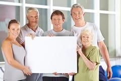 Senior people holding white empty Royalty Free Stock Photo