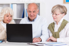 Senior people with laptop Royalty Free Stock Photos