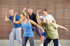 Senior people learning dancing in gym class Stock Images