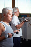 Senior people lifting dumbbells Royalty Free Stock Images