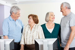 Senior People Looking At Each Other In Computer Class Stock Images