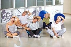Senior people loosing nape during back training. In gym Stock Photos