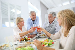 Senior people making toast at lunch Royalty Free Stock Photography