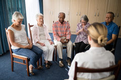 Senior people meditating with female doctor Royalty Free Stock Photography