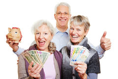 Senior people with money and piggy Royalty Free Stock Photo