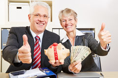 Senior people in office with dollar Stock Photos