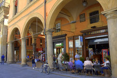 Outdoor cafe senior people Bologna Italy. Senior people relaxing at typical cafe in an archway in Bologna Italy Stock Photos