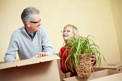 Senior people packing moving boxes Royalty Free Stock Photography
