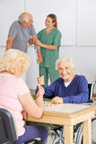 Senior people playing Bingo in nursing home Royalty Free Stock Photography
