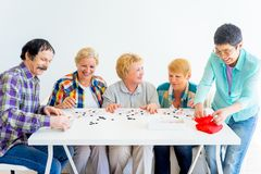 Senior people playing board games. A group of senior people playing board games Royalty Free Stock Photos