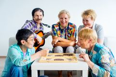 Senior people playing board games Stock Image