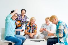 Senior people playing board games Stock Images
