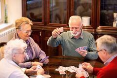 Senior people playing card games stock images