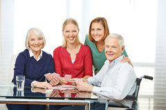 Senior people playing cards with granddaughter Royalty Free Stock Photos